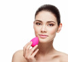 Beautiful young woman applying makeup using beauty blender sponge.